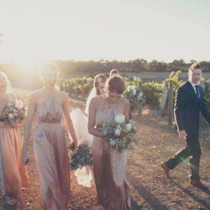Happy Bridesmaids And Groomsman Walking.