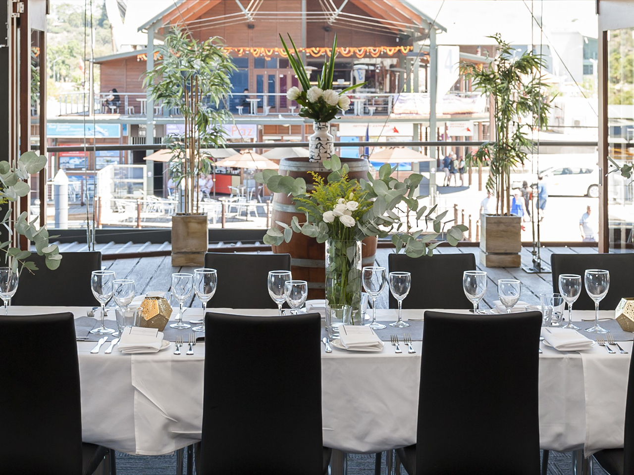 Chairs And A Long Table Setup For A Corporate Event With A Balcony Behind at the Perth Function Venue