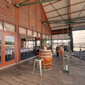 Perth Function Venue Balcony With Wine Casks As Table With Chairs And River Views