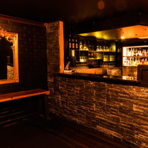 Mini Bar With Wall Mirror On The Side Inside The Function Room