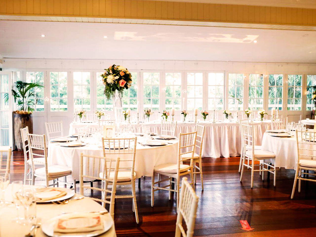 Wedding dining setting overlooking balcony and garden